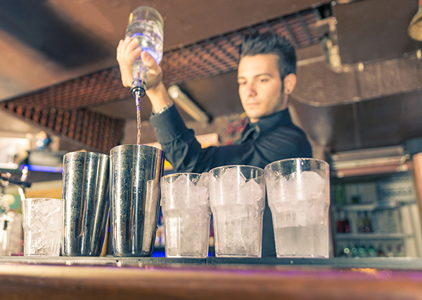 Bartender Making Gin and Tonic